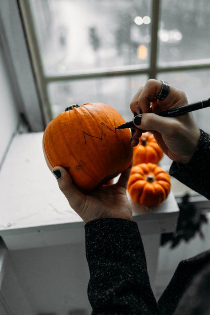 person making a jack o lantern